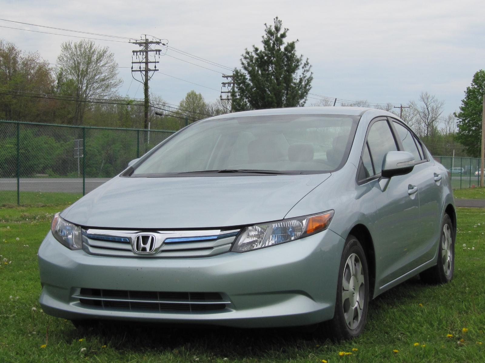 2012 honda civic hybrid hammer it how high is gas mileage. Black Bedroom Furniture Sets. Home Design Ideas