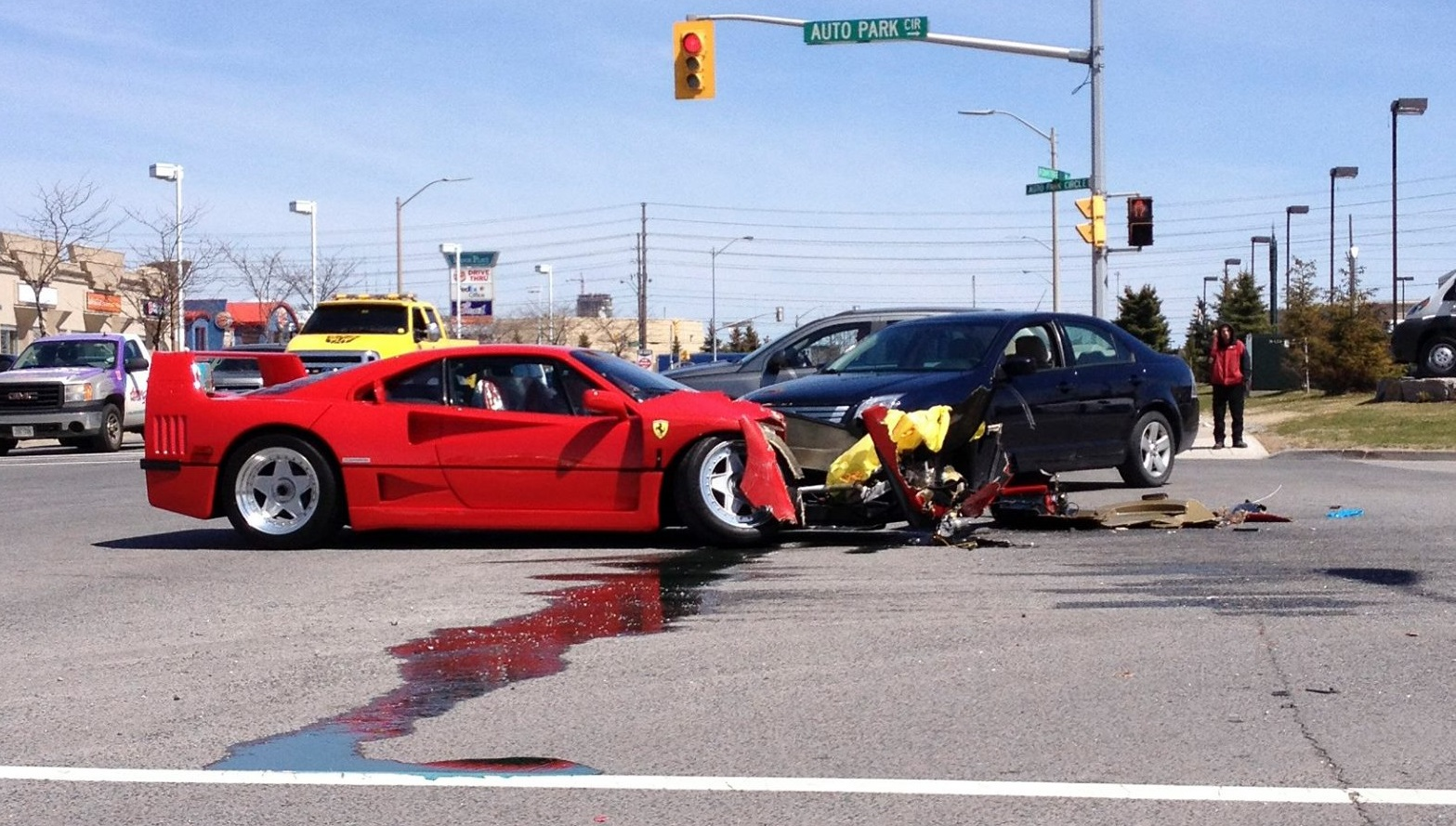 Ferrari F40 Loses Head Butting Contest With Dodge Dart On