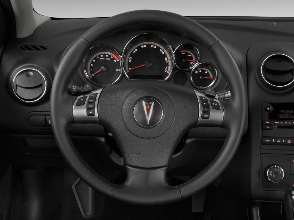 image 2009 pontiac g6 4 door sedan w 1sv steering wheel. Black Bedroom Furniture Sets. Home Design Ideas