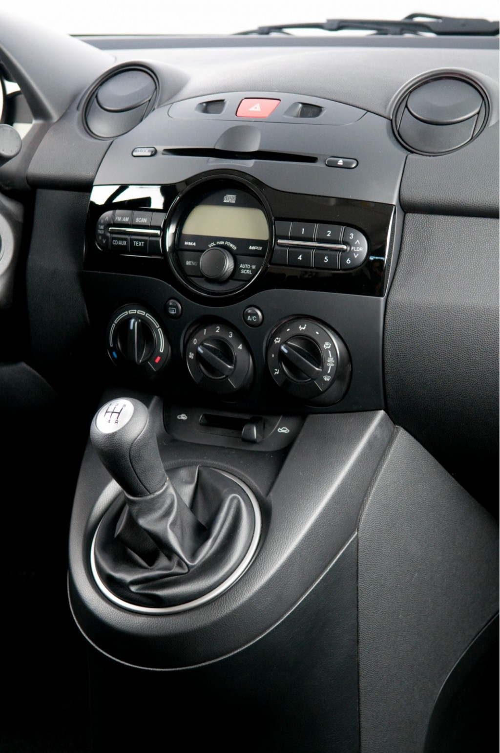 2011 mazda2 interior revealed still not as snazzy as ford fiesta. Black Bedroom Furniture Sets. Home Design Ideas