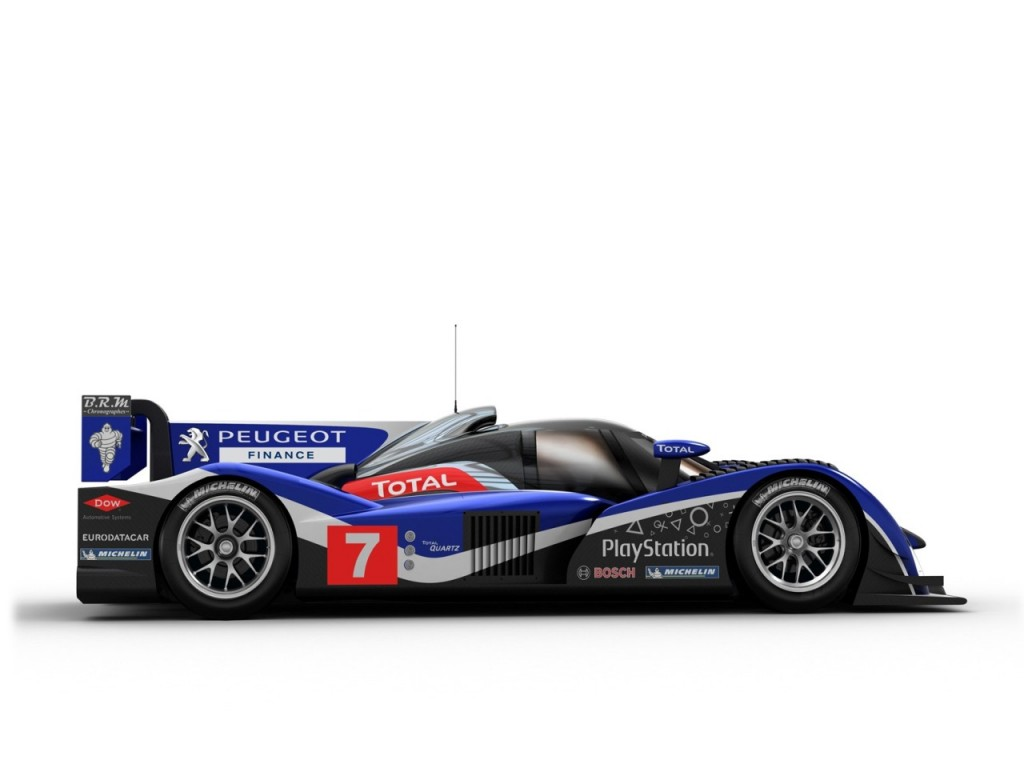 Peugeot unveils diesel powered 908 le mans race car for Garage automobile le mans