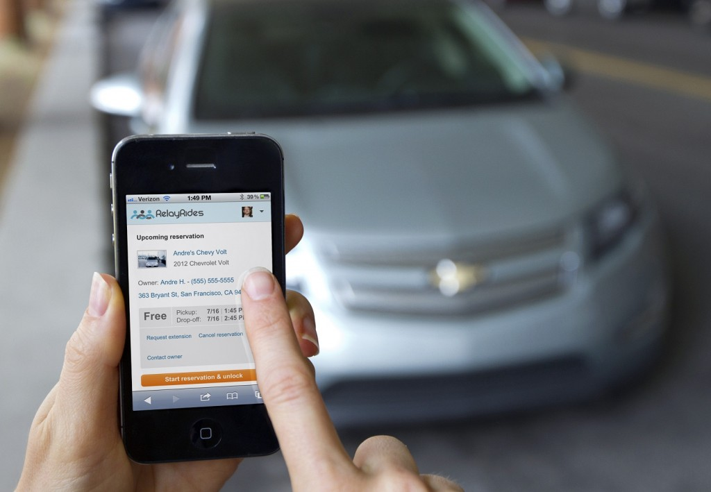 Relay Rides smartphone app for car sharing, with 2012 Chevrolet Volt in background