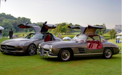 2010 Mercedes-Benz SLS AMG and 1958 Mercedes 300SL Gullwing.