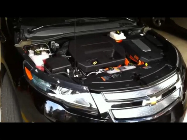 2011 Chevrolet Volt with hood open, showing range extender engine and Voltec drive #9841794