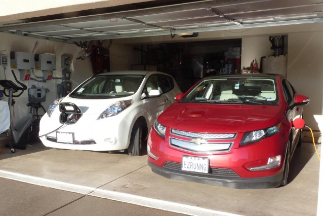 2011 Nissan Leaf and 2011 Chevy Volt, with charging station visible; photo by George Parrott #7169129