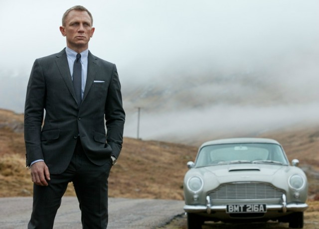 Daniel Craig as James Bond, Agent 007, in Skyfall, with Aston Martin DB5