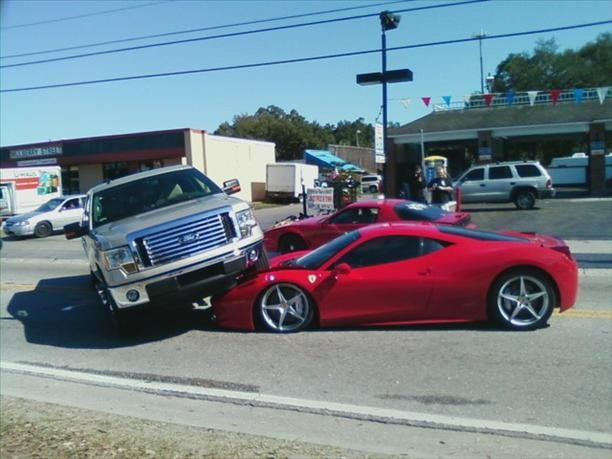 Ferrari 458 Italia gets run over by Ford F-150 pickup truck