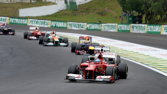 Ferrari's Fernando Alonso leads a pack of drivers at the 2012 Formula 1 Brazilian Grand Prix