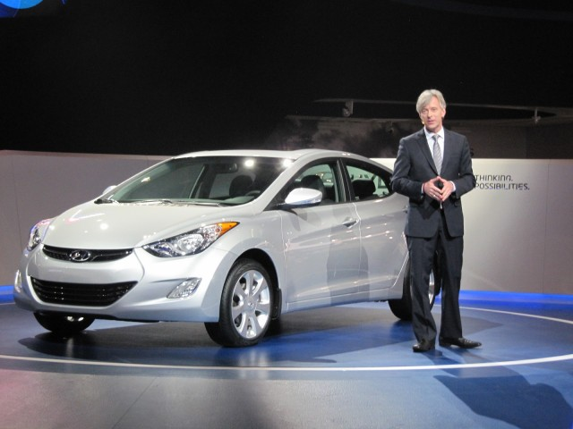 John Krafcik, CEO of Hyundai America, with 2012 Hyundai Elantra sedan at Chicago Auto Show, Feb 2012 #9349959