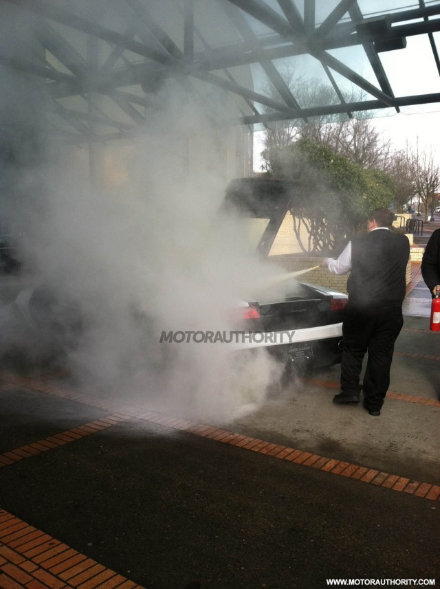 Lamborghini Gallardo on fire at 2012 Portland Auto Show. Photo credit Larry Coppola.