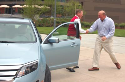 Microsoft CEO Steve Ballmer takes delivery of a 2010 Fusion Hybrid from Ford CEO Alan Mulally #7982462