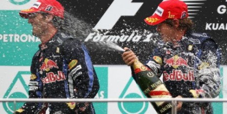 Red Bull's Sebastian Vettel and Mark Webber on the podium at the 2010 Malaysian Grand Prix
