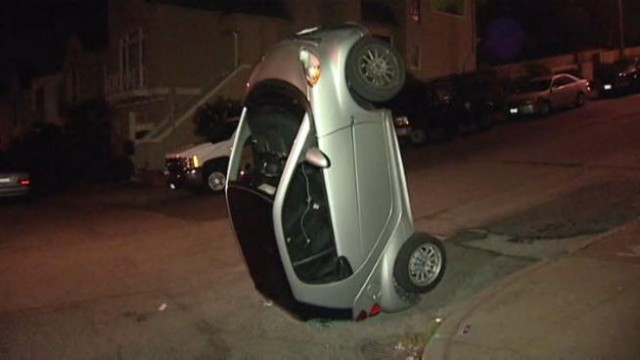 tipped over smart car