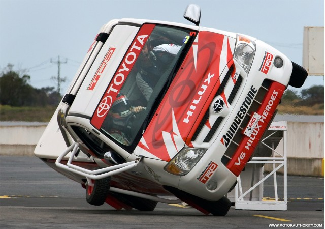 Timo Glock goes up on two wheels in a Toyota Hilux