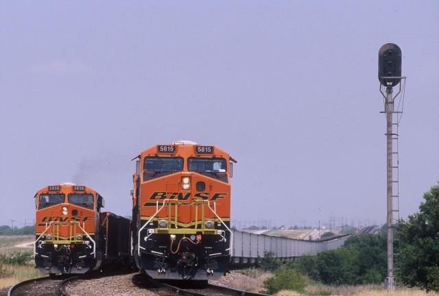 Two BNSF locomotives hauling coal trains meet near Wichita Fall