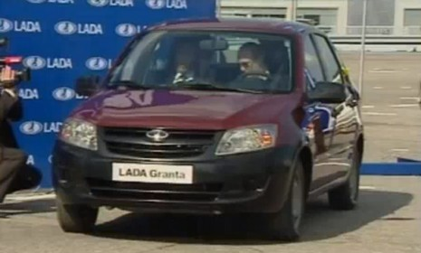 Vladimir Putin trying to start a Lada Granta
