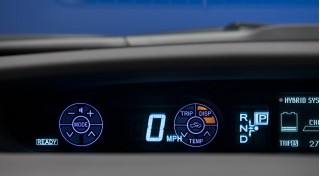 2010 Toyota Prius showing Touch Tracer indicators floating over Driver Information Area