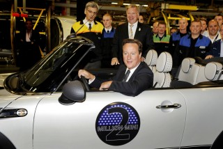 British Prime Minister David Cameron driving the two-millionth MINI produced. Image: MINI