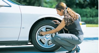 ladie checking tire pressure