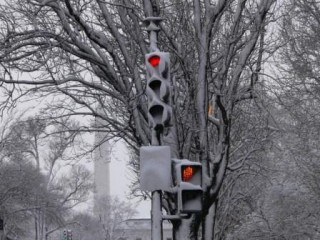 Winter driving - snowy signal - AAA Foundation for Traffic Safety